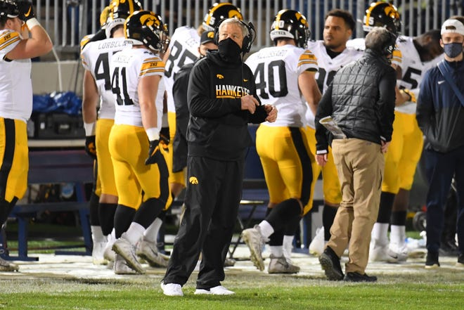 Iowa head football coach Kirk Ferentz looks at the video board during a game against Penn State on Nov. 21 in University Park, Pa.