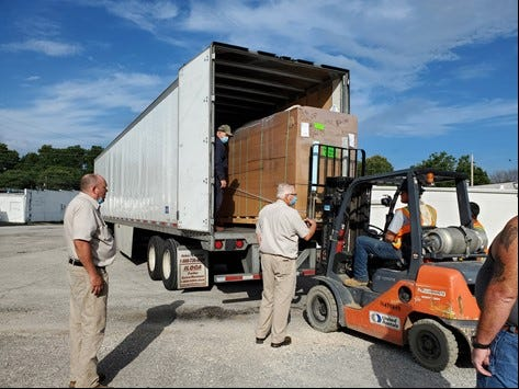 Helping Hand of Humboldt receives a shipment of food it will need to store in the new freezer donated to it from Amerigroup Tennessee earlier this month.