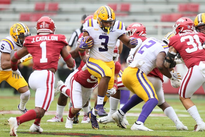 Nov 21, 2020; Fayetteville, Arkansas, USA; LSU Tigers running back Tyrion Davis-Price (3) runs with the ball in the first half against the Arkansas Razorbacks at Donald W. Reynolds Razorback Stadium. Mandatory Credit: Nelson Chenault-USA TODAY Sports