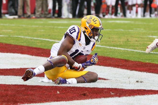 Nov 21, 2020; Fayetteville, Arkansas, USA; LSU Tigers wide receiver Jaray Jenkins (10) catches a pass for a touchdown in the fourth quarter against the Arkansas Razorbacks at Donald W. Reynolds Razorback Stadium. Mandatory Credit: Nelson Chenault-USA TODAY Sports