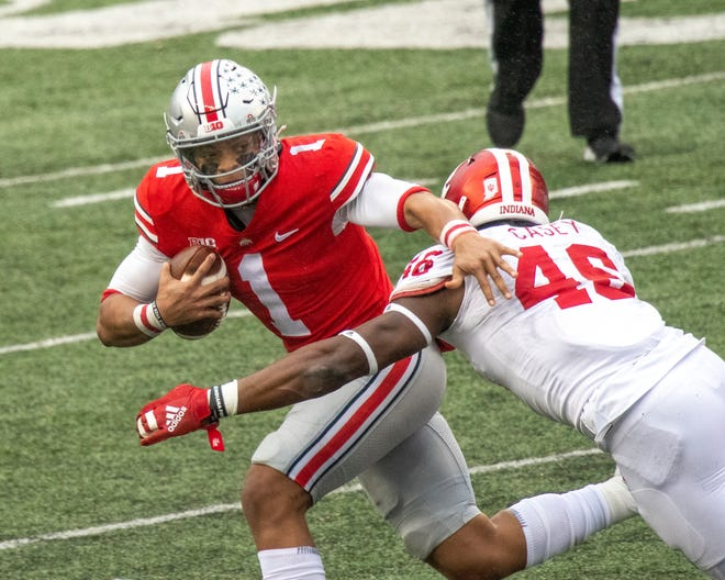 Ohio State quarterback Justin Fields faced relentless pressure from Indiana, throwing his first three interceptions of the season while also accounting for 378 yards total offense and 3 touchdowns