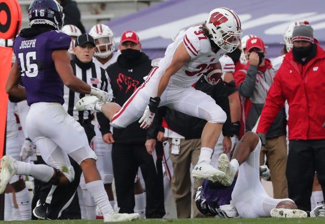 Wisconsin running back Garrett Groshek hurdles a Northwestern defender.