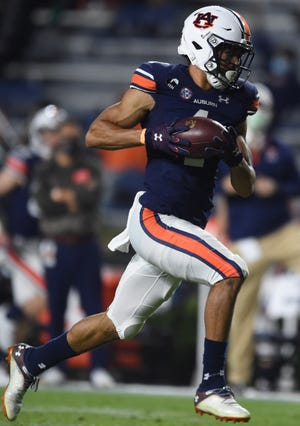 Auburn wide receiver Anthony Schwartz (1) runs a completed pass in to the end zone for a touchdown at Jordan-Hare Stadium in Auburn, Ala., on Saturday, Nov. 21, 2020.