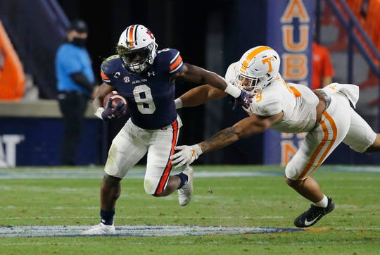 Nov 21, 2020; Auburn, Alabama, USA;  Auburn Tigers running back Shaun Shivers (8) runs the ball against Tennessee Volunteers linebacker Tyler Baron (9) during the second quarter at Jordan-Hare Stadium. Mandatory Credit: John Reed-USA TODAY Sports