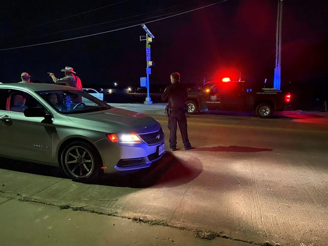 Wichita County deputies and Wichita Falls police search for suspects on Harding Street after a vehicle pursuit Saturday night.