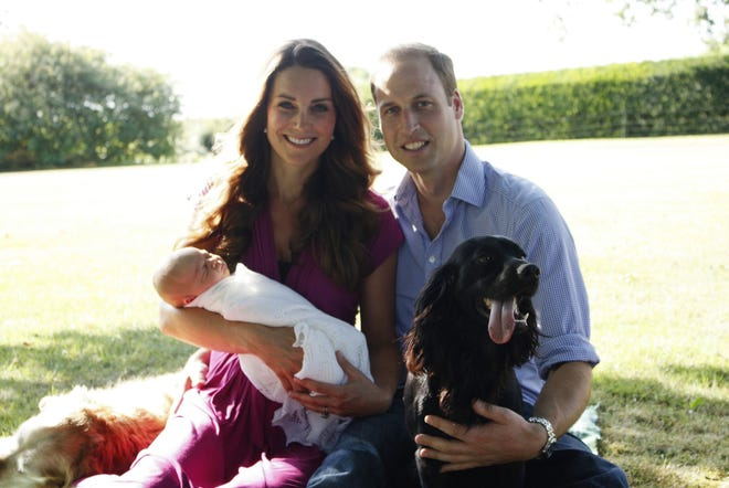 A photo released by Kensington Palace on Aug. 19, 2013, shows Prince William and Duchess Kate with their newborn baby boy, Prince George; Tilly the retriever (left), a Middleton family pet; and Lupo, the couple's cocker spaniel, at the Middleton family home in Bucklebury, Berkshire.