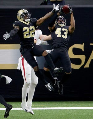 Marcus Williams #43 of the New Orleans Saints intercepts a pass intended for Russell Gage #83 of the Atlanta Falcons as teammate Chauncey Gardner-Johnson #22 of the New Orleans Saints assists in the second quarter at Mercedes-Benz Superdome on November 22, 2020 in New Orleans, Louisiana.