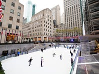 People ice skate as The Rink at Rockefeller Center in Manhattan opens for the season on Nov. 21, 2020, with limited capacity and mandatory face masks, safety precautions related to the coronavirus pandemic.