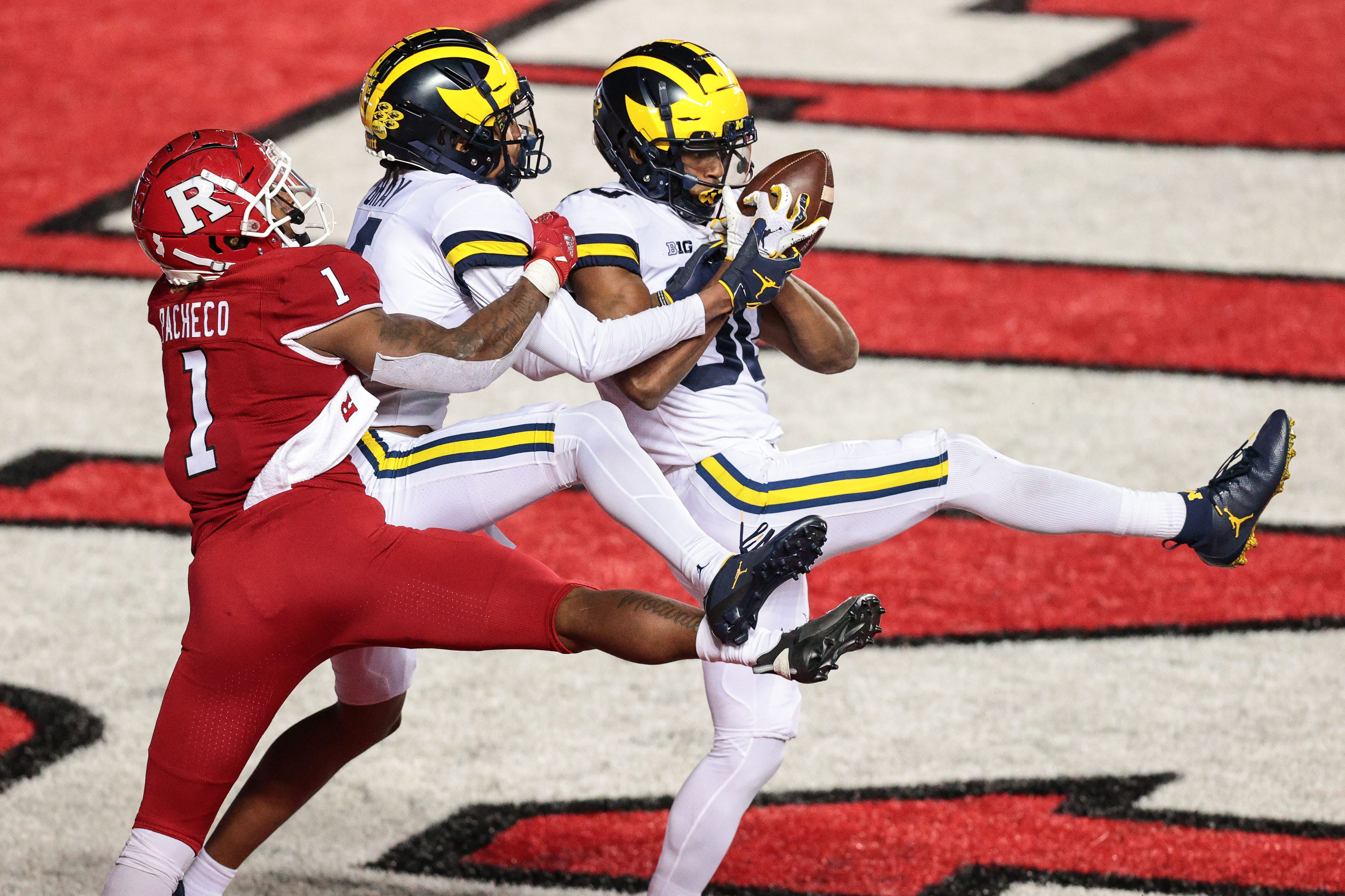 Michigan comes back from 17 down, clips Rutgers in triple overtime to end losing streak