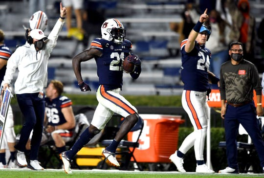 Auburn defensive back Smoke Monday returns an interception for a touchdown against Tennessee.
