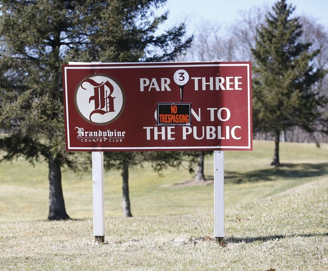 """A """"No Trespassing"""" message is seen on the Brandywine Country Club sign along Akron-Peninsula Road in March 2019 in Peninsula."""
