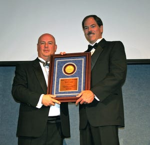 At a black-tie dinner in Washington, D.C., in July 2008, Beacon Journal columnist Bob Dyer (right) was honored by the National Society of Professional Journalists as the Best Columnist in the Nation. Dyer is retiring Tuesday after 36 years at the newspaper.