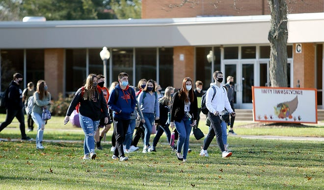 Students leave Ashland High School at the end of the school day on Nov. 23.