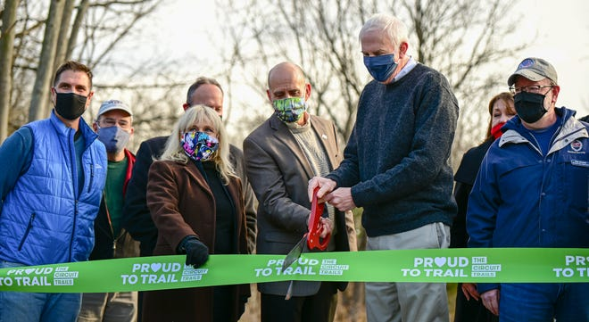 County and local officials gathered last Thursday to cut the ribbon on a new rail trail through upper Bucks County.