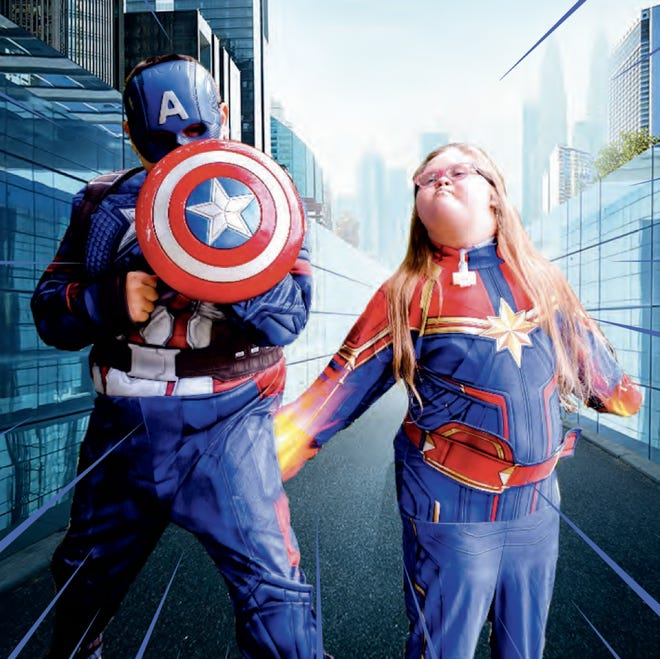 Brodi, left, and Jordin Babilon, children of Rian and Tammi Babilon of Rochester Township, are featured in the 2021 Superheroes Believe in Miracles calendar. Brodi is Captain America and Jordin is Captain Marvel.