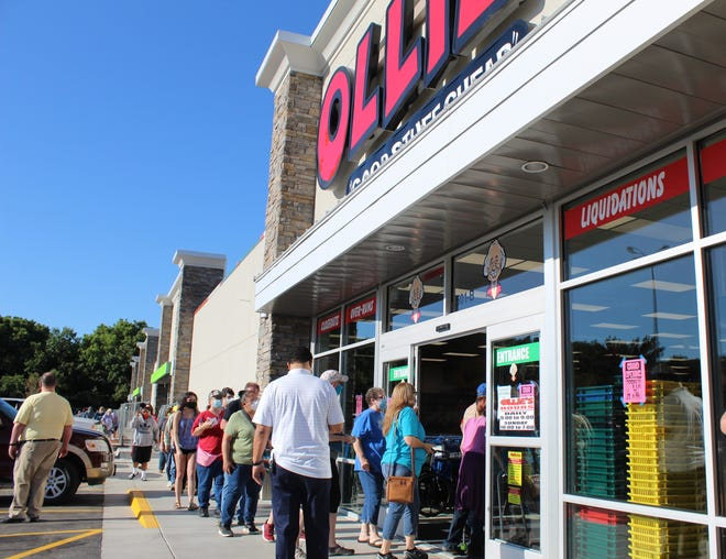 Shoppers line up for the grand opening of Bartlesville's new Ollie's Bargain Outlet on Aug. 19.