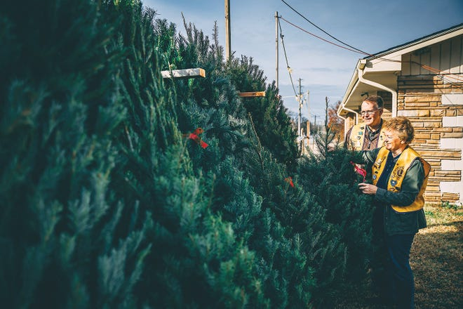 Kevin and Debbie Reid have helped the Bartlesville Lions Club for the past 15 years sell Christmas trees to help fund charity projects around town; this year's proceeds will go to renovate Tuxedo Park located next to the Lions' building.