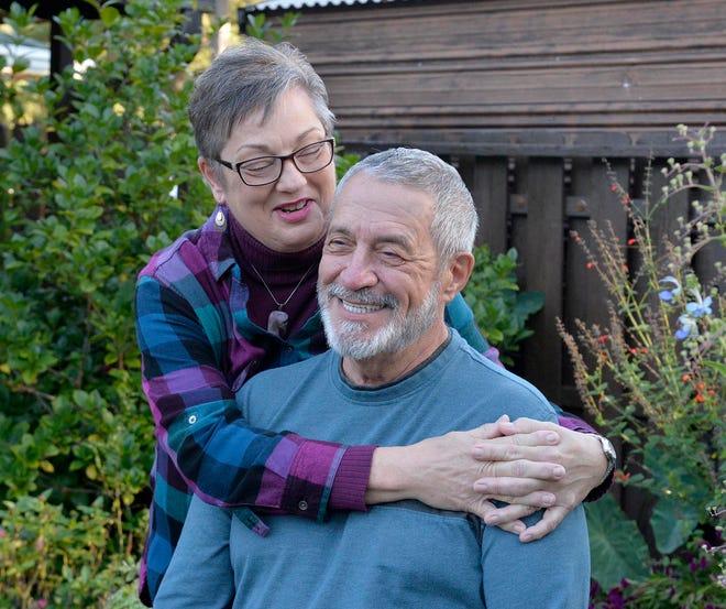 Rod and Deb Stephenson in their backyard garden.