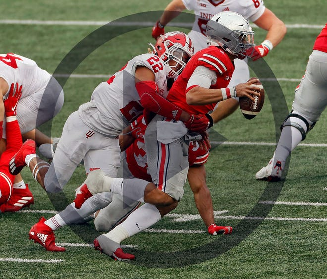 In this file photo, Indiana Hoosiers defensive back Jamar Johnson (22) sacks Ohio State Buckeyes quarterback Justin Fields (1) during the third quarter in their NCAA Division I football game on Saturday, Nov. 21, 2020 at Ohio Stadium in Columbus, Ohio.