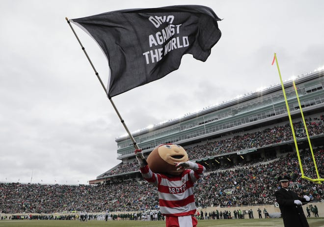 Brutus the Buckeye rallies Ohio State Buckeyes fans during a break in play in the second quarter of a NCAA college football game between the Michigan State Spartans and the Ohio State Buckeyes on Saturday, November 10, 2018 at Spartan Stadium in East Lansing, Michigan. [Joshua A. Bickel/Dispatch]