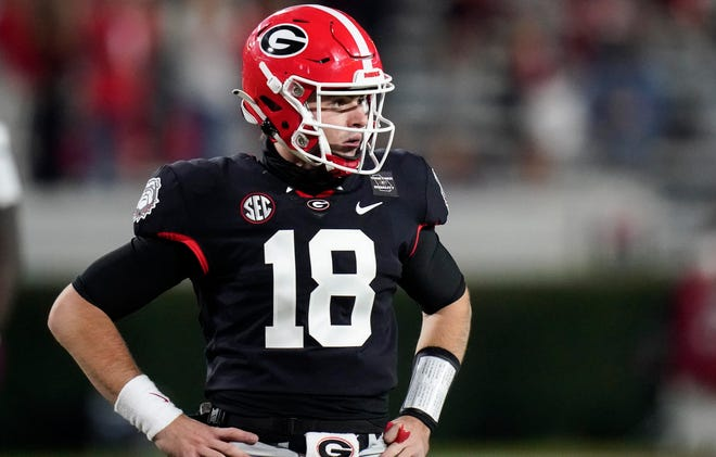 Georgia quarterback JT Daniels looks for a play call from the sideline during the first half against Mississippi State on Saturday.