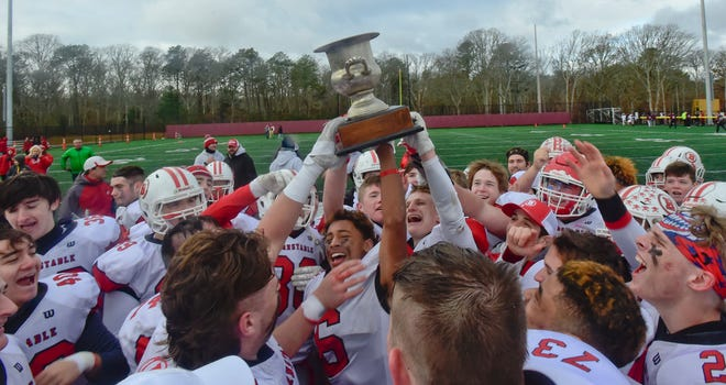 The Barnstable team hoists the Selectman's Cup after beating Falmouth in their traditional Thanksgiving Day game in 2019. The traditional Thanksgiving Day high school football games are off the table this year, thanks to the coronavirus pandemic.