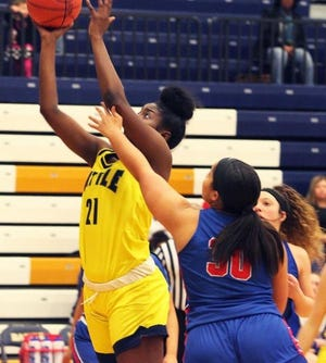 Battle's Ke'shai Hayes (21) scores from close range during a game against Moberly on Feb. 7 at Battle High School.
