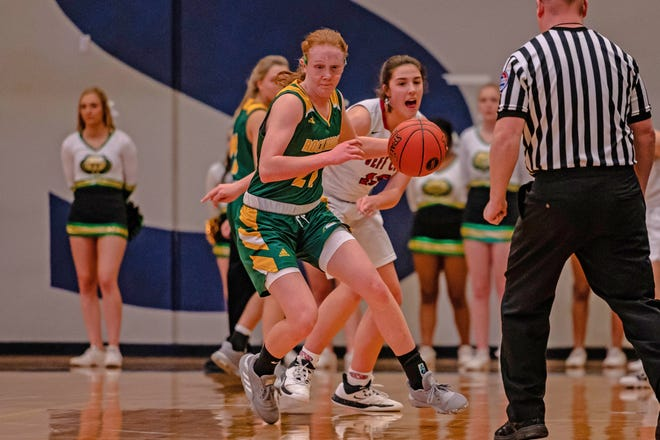 Rock Bridge's Averi Kroenke (21) steals a pass away from Jefferson City's Sarah Linthacum (13) during the Class 5 District 9 championship on March 6 at Battle High School. Kroenke is committed to Missouri women's basketball, while Linthacum recently signed with the program.