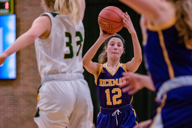 Hickman's Ella Rogers (12) looks to pass the ball to the inside during a game against Rock Bridge on Jan. 30 at Rock Bridge High School.