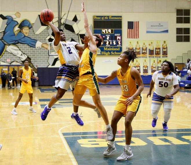 Mainland's Jalen Willis (2) takes a shot during a game with Forest at Mainland High School in Daytona Beach, Thursday, Feb. 20, 2020. [News-Journal/Nigel Cook]