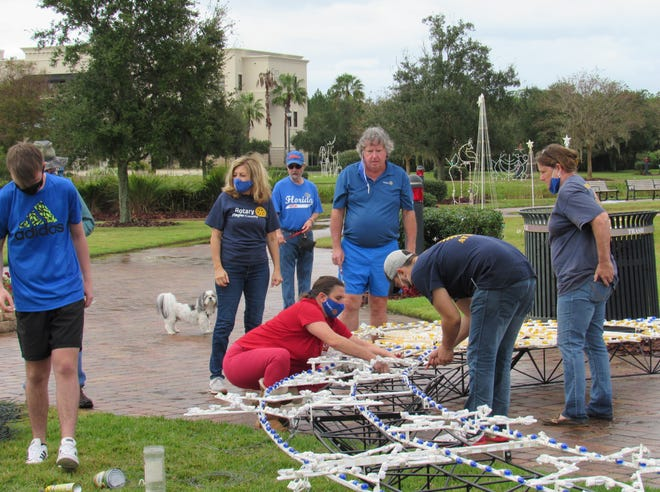 On Sunday, members of several Rotary clubs from District 6970 work to put up the 15th Annual Fantasy Lights display, hosted by the Rotary Club of Flagler County in Central Park, to kick off the holiday season on Nov. 28.