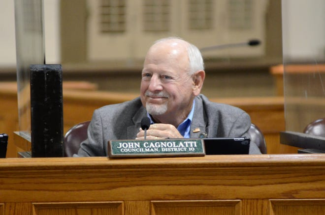 Ascension Parish council member John Cagnolatti smiles during a meeting held earlier this month.
