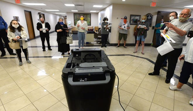 Election poll workers train in May at the Erie County Courthouse on new voting machines in place for the first time in the June 2 primary and the precautions to be taken during the COVID-19 pandemic.