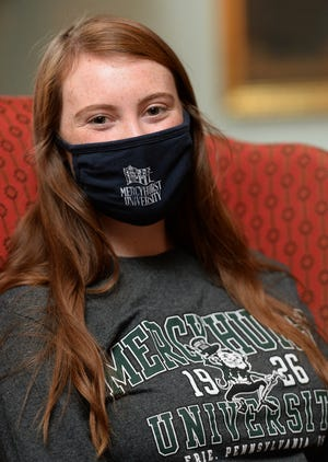 Mercyhust University student Marina Boyle, shown Monday inside Mercyhurst's Old Main building had to quarantine in August upon her arrival from Ireland and isolate in November when she tested positive for COVID-19.