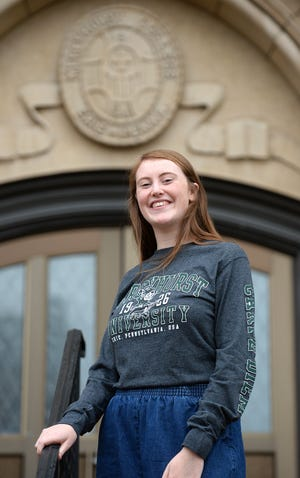 Marina Boyle, a Mercyhust University student from Ireland is shown Monday outside Mercyhurst's Old Main building. Boyle had to quarantine in August upon her arrival and isolate in November when she tested positive for COVID-19.