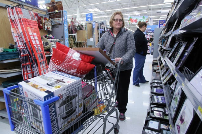 Margie Spears pushes her shopping cart loaded with Black deals as she browses through the aisles at Walmart Nov. 25, 2016 in West Burlington. Most retail stores started online Black Friday specials before the traditional holiday rush that started at some stores on Thanksgiving day. This year due to COVID-19 most retail stores will be closed Thanksgiving day.