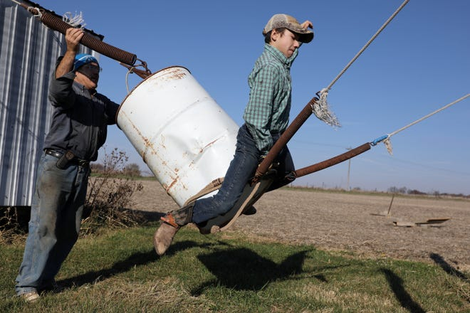 Cade Lundvall, 13, rides a bucking barrel while practicing with his father Lee,   nest to  the family arena, Saturday Nov. 7, 2020 South of Wapello. Cade will be traveling to Guthrie, Oklahoma in January to compete at the International Miniature Rodeo Association finals along with his sister Madi, who is competing in barrel racing.