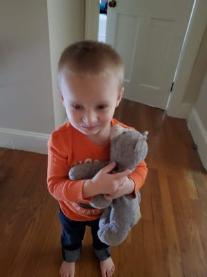Sara Flowers is searching for her 3-year-old son Jaymison's favorite toy, a gray stuffed cat named Slippers. Jaymison, who has autism, has had a hard time since he lost slippers on the Dover Community Trail on Nov. 14.