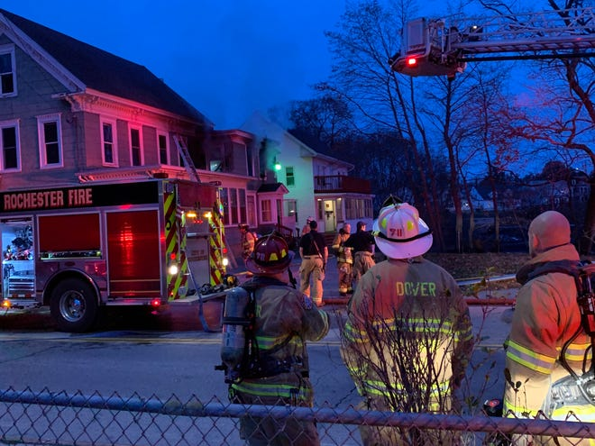 A fire at this two-building Bridge Street property displaced 12 total residents and killed one cat Sunday afternoon. Firefighters rescued two residents who became trapped on the roof of a second-story porch while trying to escape their unit.