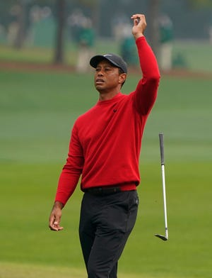 Tiger Woods reacts after a near chip in on the second hole during the final round of the Masters on Sunday, Nov. 15, 2020, in Augusta, Ga. [AP Photo/Chris Carlson]