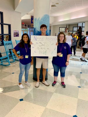 Swansboro High School students in the Student 2 Student (S2S) program help students find their classes on the first day of school in 2019.