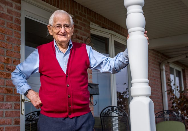 Cleo Koch stands on the front porch of his Tremont residence on Nov. 23, 2020.