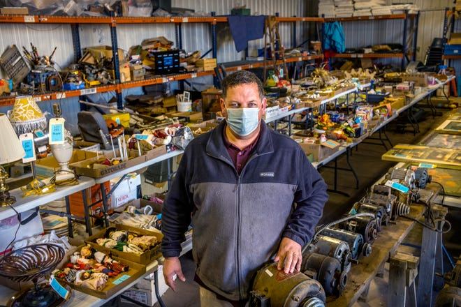 JK Auctions owner Jim Kellerstrass stands Wednesday, November 18, 2020 in the middle of thousands of items offered in his most recent online auction in his companyÕs Washington facility. Kellerstrass hopes sometime soon to be able to offer in-person auctions.