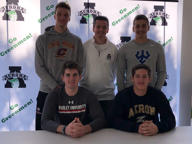 Four Aurora High School baseball players announced they will continue their athletic careers at the college level. They are, from left (sitting), Michael Mylott, an outfielder and third baseman who will attend Bradley University, and right-hand pitcher and catcher Andrew Horvath who will attend the University of Akron. Standing are left-hand pitcher Jack Fecko who will attend Central Michigan University, Aurora head coach Michael Brancazio and third baseman-first baseman Michael Carpenter who will attend Washington & Lee University.