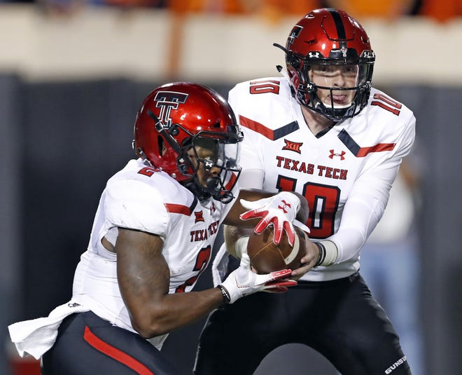 Texas Tech quarterback Alan Bowman (10) hands off to DeMarcus Felton during the Red Raiders' 41-17 victory in September 2018 at Oklahoma State. After that game, Bowman was 3-0 as a starter with a 22-for-25 showing for 282 yards against Lamar, 605 yards passing and five touchdowns against Houston and 397 yards and two TDs against OSU. But he's had a series of misfortunes ever since.