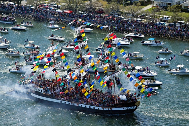 The Jose Gasparilla makes its way along Seddon Channel in Tampa in January 2014 with hundreds of pirates aboard, as a flotilla of boats follow to kick off the Gasparilla pirate invasion. The annual parade Gasparilla Pirate Fest is now planned for mid-April amid continuing health care concerns.