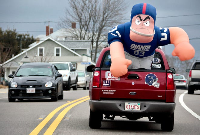 A pickup truck drives displaying an inflated New York Giants character before the team's Super Bowl XLVI win over the New England Patriots in February 2012. New York ranks first as the birthplace of present-day Floridians with 7.5% of the state's population born there.