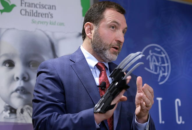 "James Swartz, director of the Massachusetts-based consumer safety group World Against Toys Causing Harm, or W.A.T.C.H., displays a Black Panther ""slash claw"" as he introduces toys topping the group's annual list of worst toys for the holiday season, during a November 2018 news conference at a hospital in Boston."