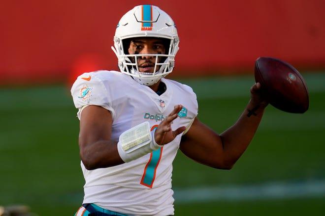 Dolphins quarterback Tua Tagovailoa surveys the field in Denver.