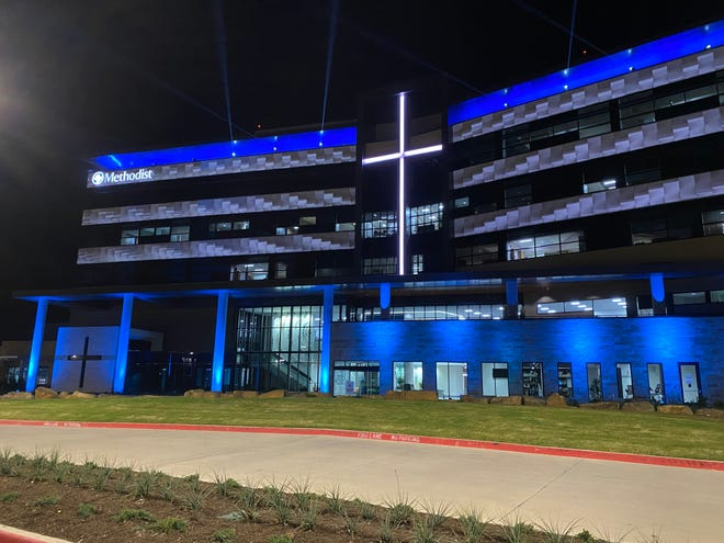 Laser lights shine from the exterior of the new Methodist Midlothian Medical Center on Saturday night in celebration of the hospital's long-awaited opening. Methodist Midlothian is the first acute-care hospital in the city's history.